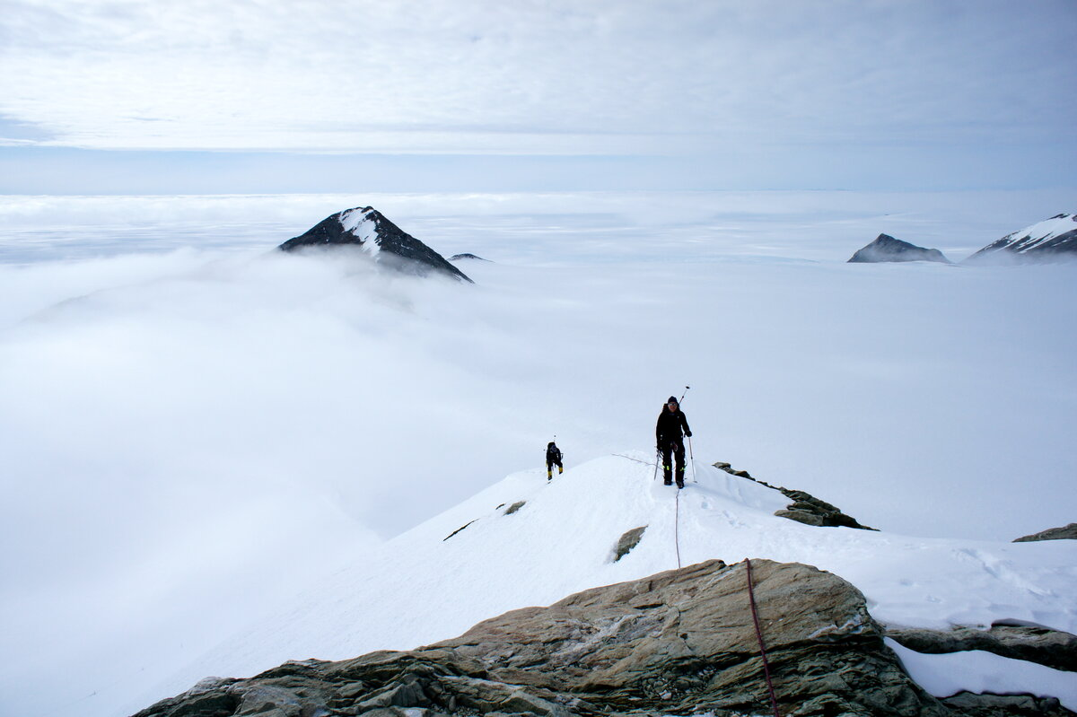 Climbing above the fog on east ridge of Mount Rossman