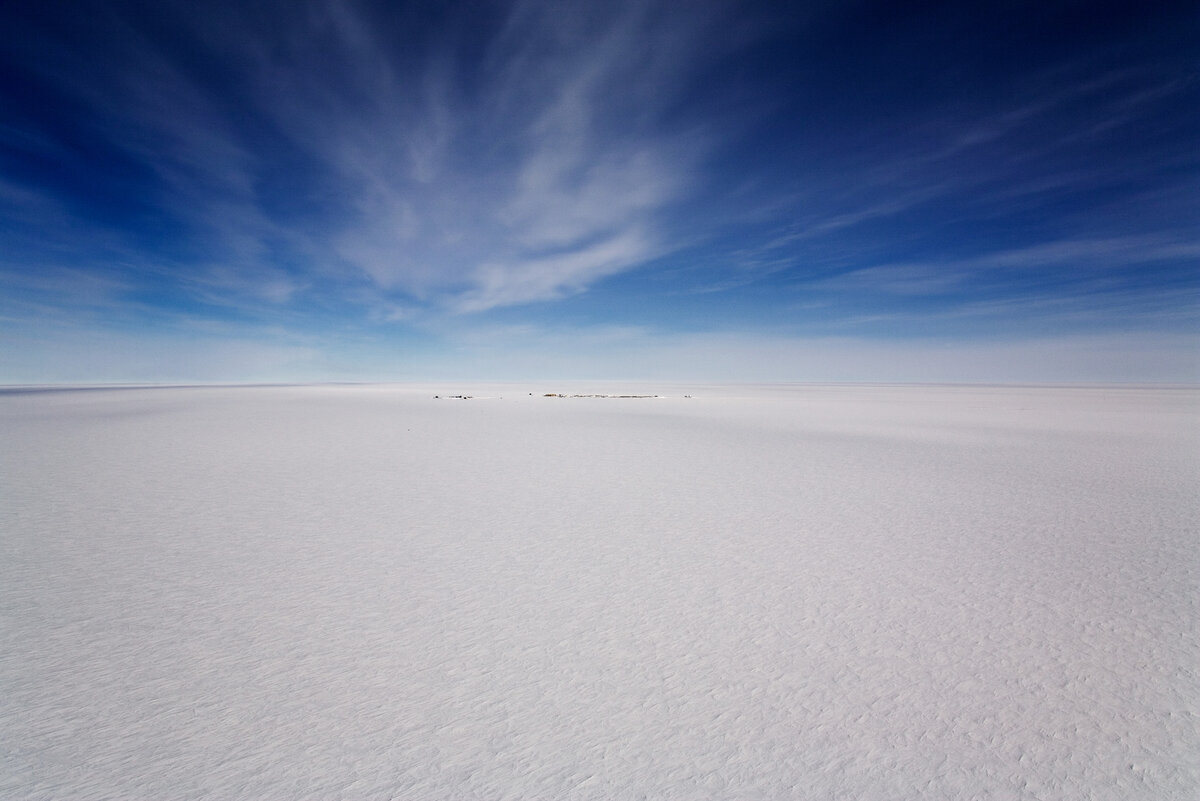 The polar plateau is a vast, featureless ice sheet