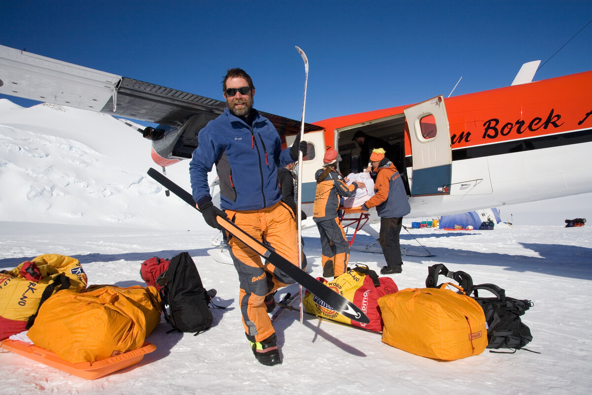 Climbers unload gear from Twin Otter upon arrival