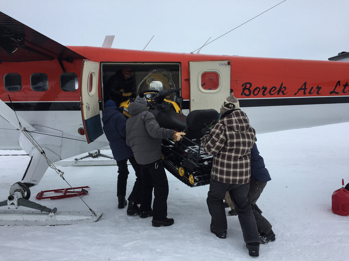 Delivering snowmobile to deep-field site