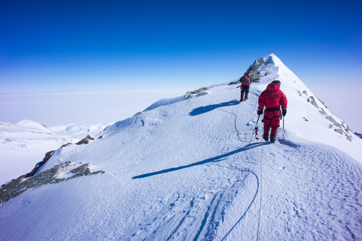 Roped climbers approach the summit of Mount Vinson