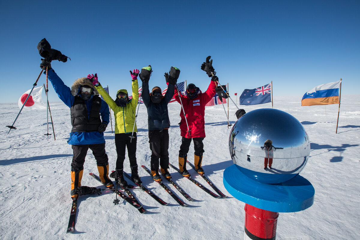 Team celebrates arrival at Ceremonial South Pole