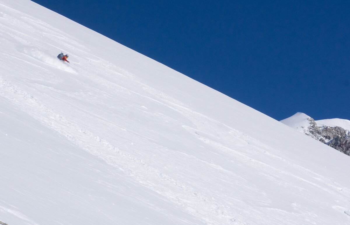 Skier descends a slope