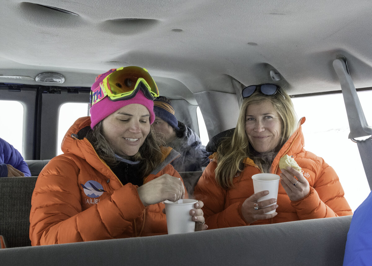 Guests enjoy hot cocoa and scones after an excursion to the Drake Icefall