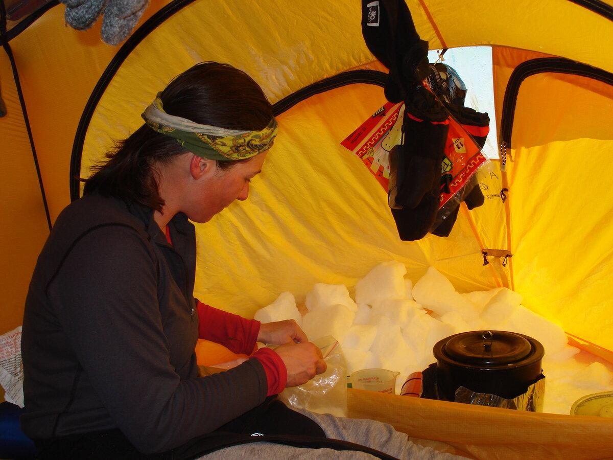 ALE guide melts snow in tent vestibule snow kitchen