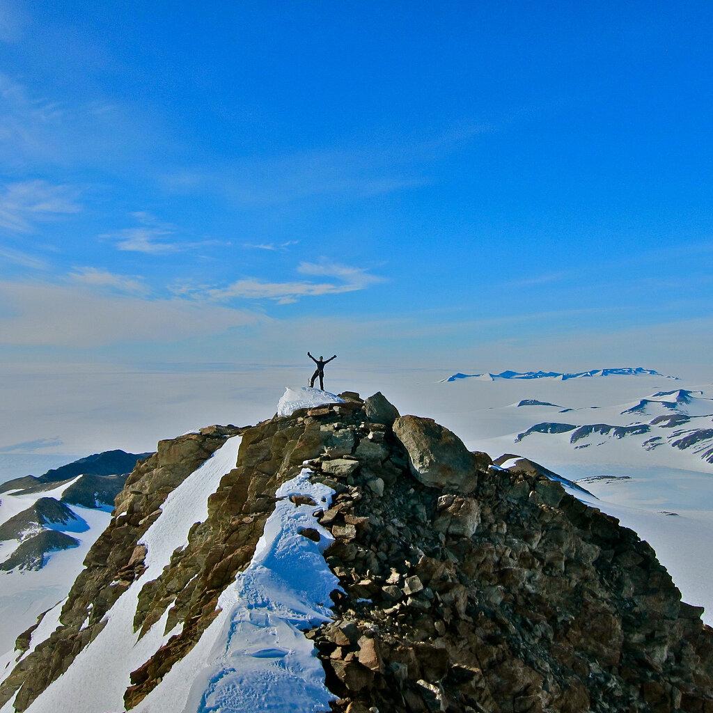 Climber on the summit of Sutton Peak