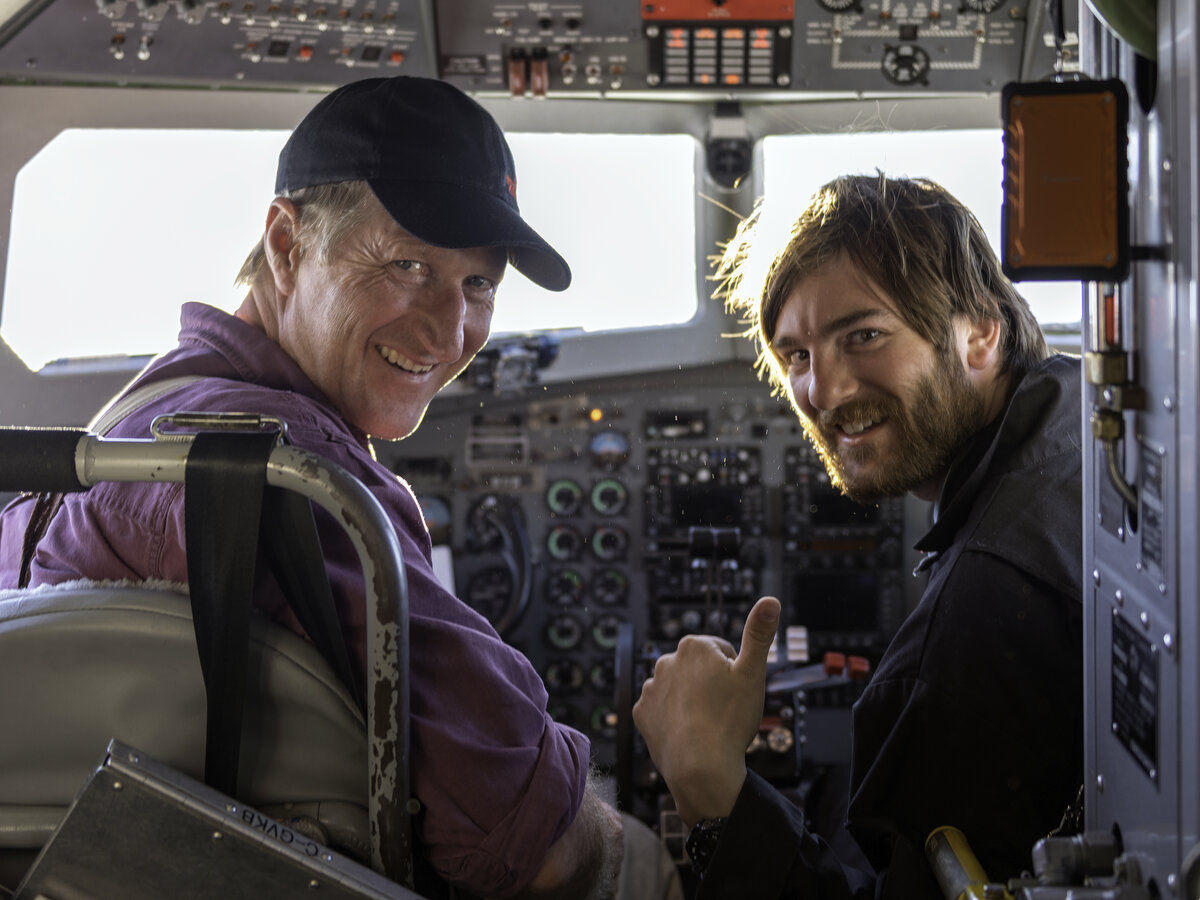 Basler Captain and Co-Pilot look back from the cockpit after a flight