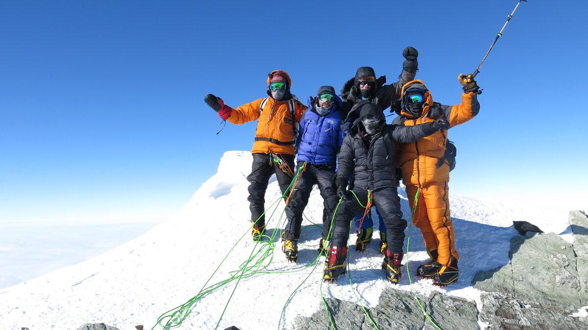 Climbing team celebrates on the summit