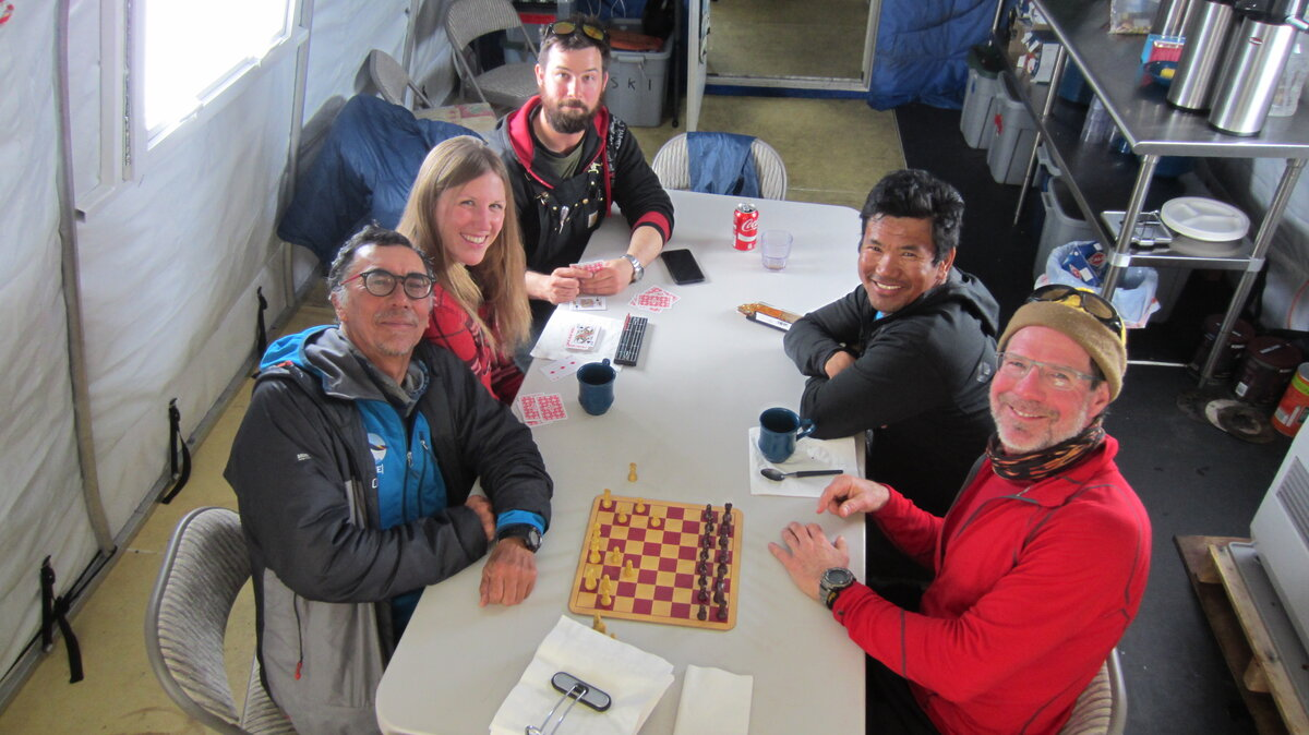 ALE staff and guests play chess in the dining tent