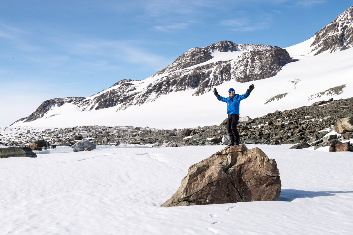A guest stands on a boulder at Elephant's Head Valley