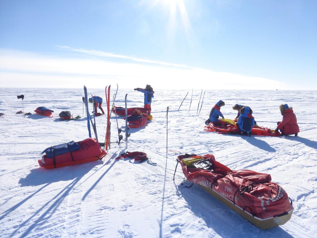 Ski team sets up camp on a sunny day