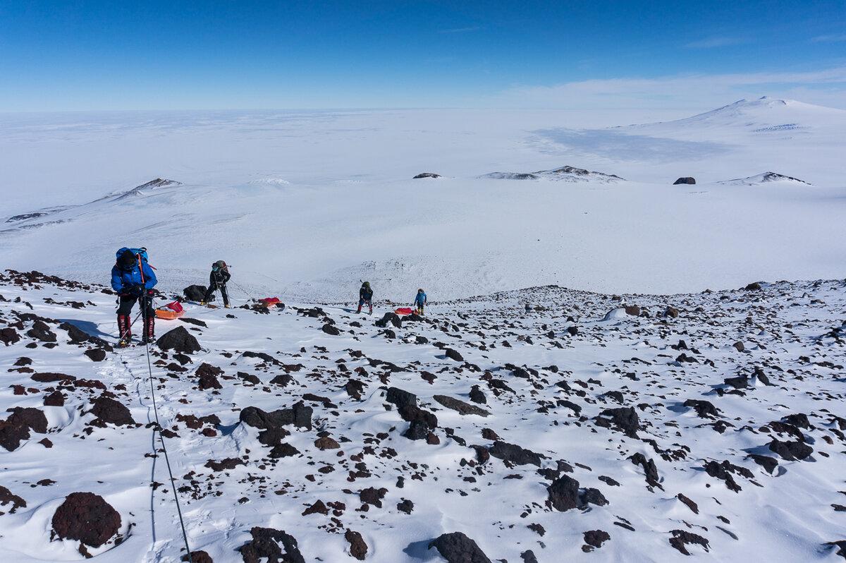 Rope team climbs a rocky ridge above Weiss Amphitheater