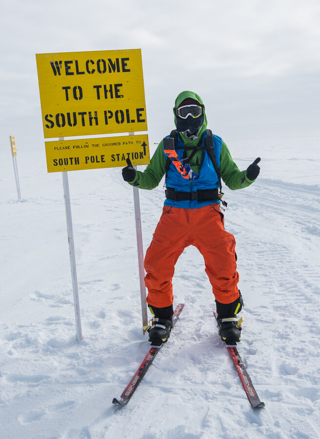 Thumbs up for reaching 'Welcome to the South Pole' sign