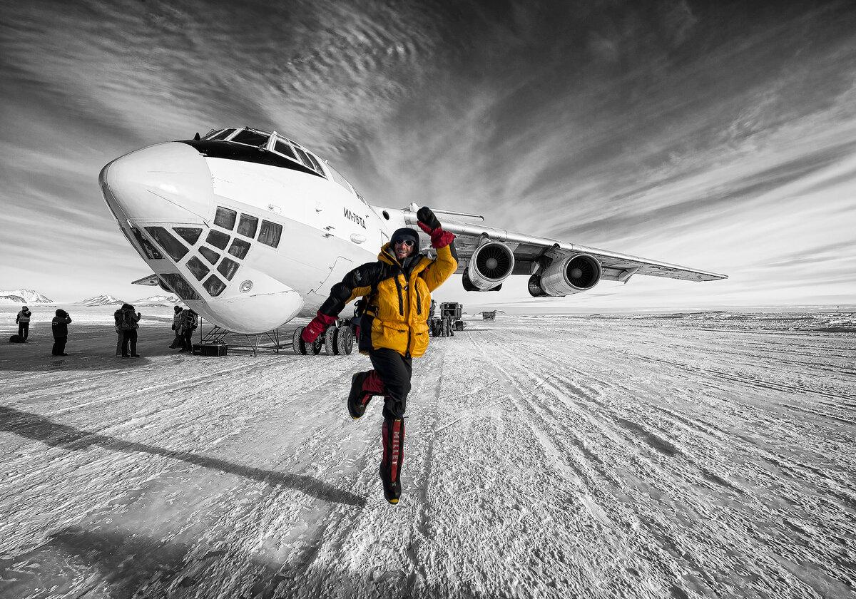 Climber celebrates after landing on Union Glacier