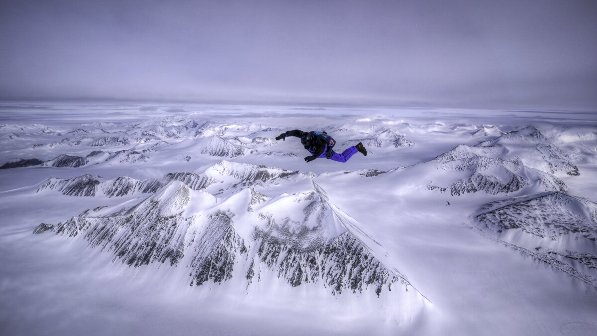A skydiver free falls over Union Glacier