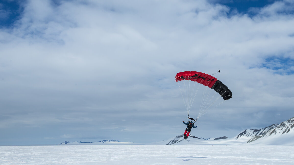 A skydiver lands on Union Glacier