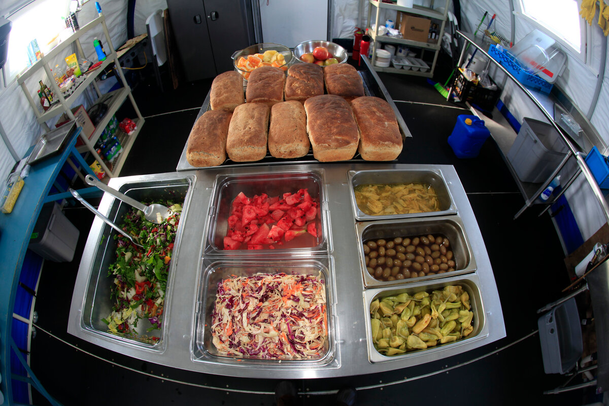 Fresh bread, fruit, and salads