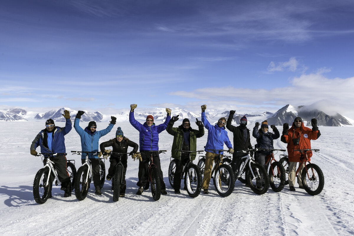 Guests and staff enjoy a bike excursion around the 10k loop outside of Union Glacier Camp