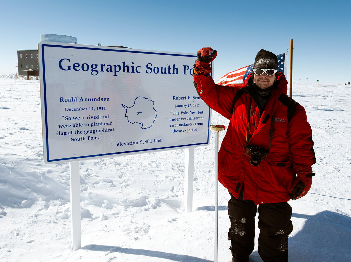 Guest gives a fist pump at the Geographic South Pole