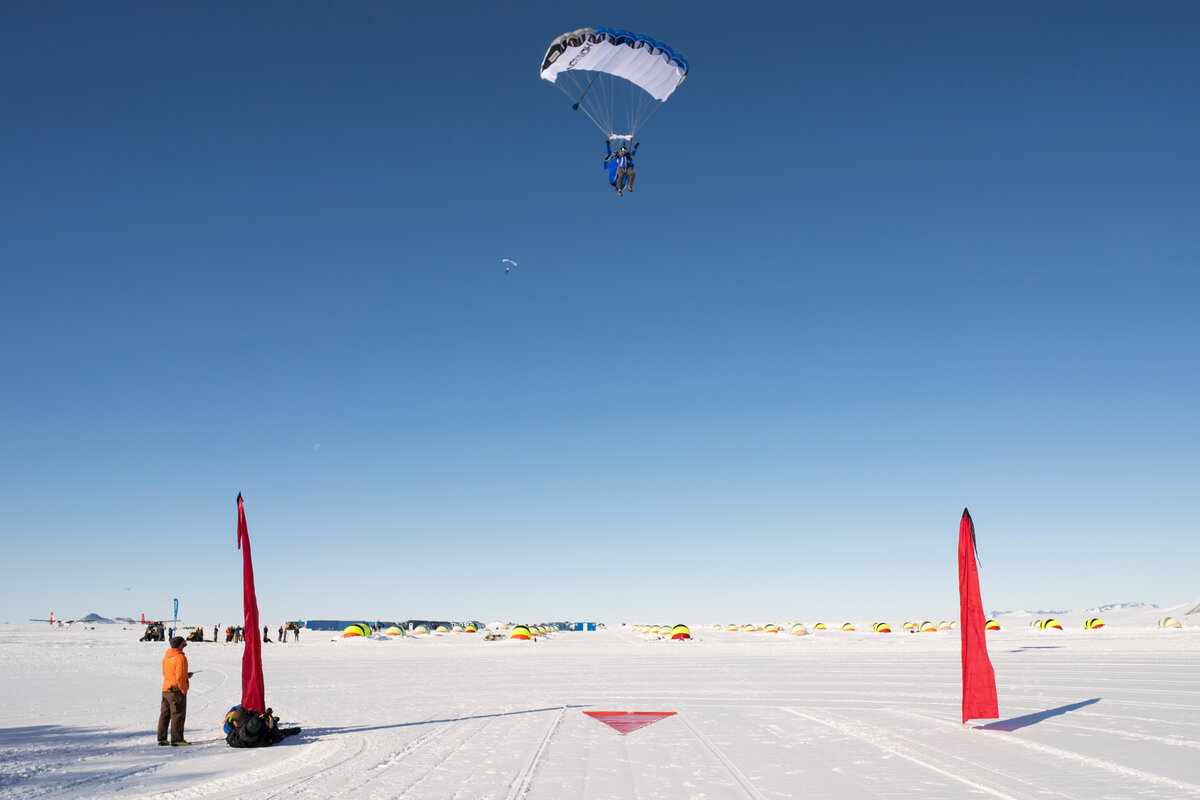 A skydiver comes in to the landing zone at Union Glacier
