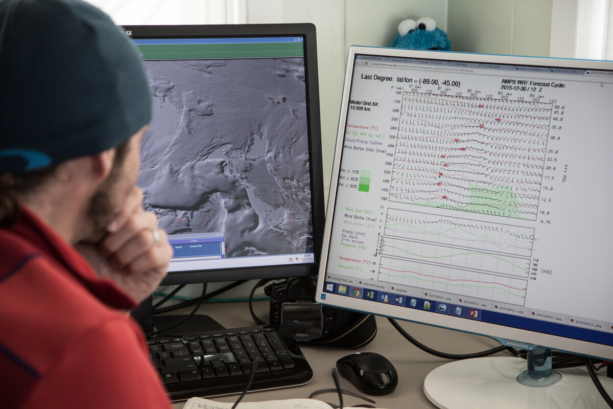 Meteorologist Marc DK. prepares a forecast