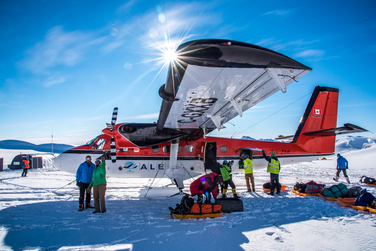 ALE staff load expedition sleds into a Twin Otter