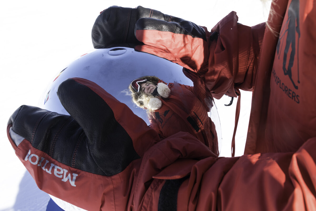 A guest looks at her reflection in the Ceremonial South Pole