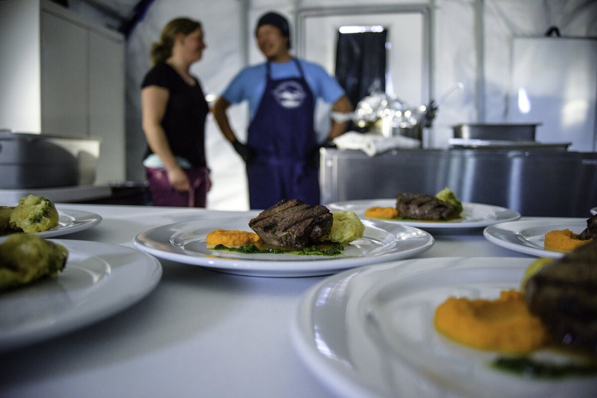 ALE staff prepare a celebration dinner for guests